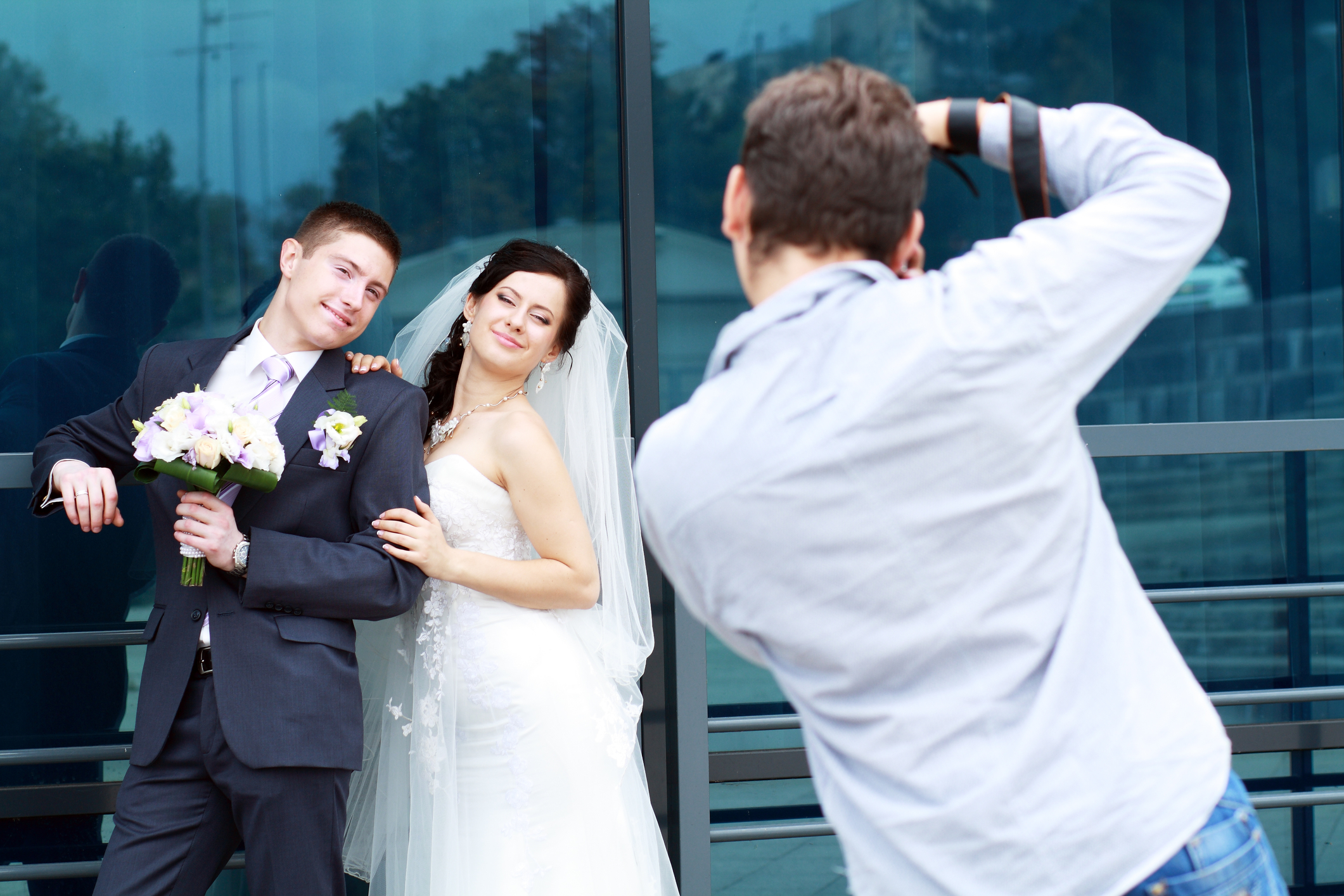 Couple posing for wedding photographs