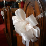 Beautiful close-up of a decorative bow used in a wedding.