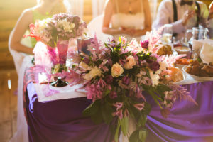 white and purple flowers wedding accessories wedding preparation decorated wedding table with flowers wedding flowers wedding bouquet food on the table people sitting at the table